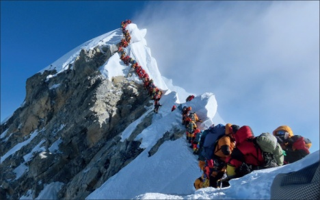 Mount Everest reopens to tourists, trekkers